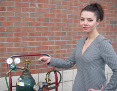 Attractive Woman using Multi-Purpose Sparkfree Antibacterial Wrench on tank's release valve